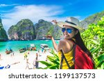 happy smiling traveler asian... | Shutterstock . vector #1199137573