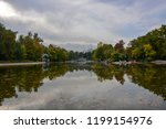 reflection of green pond and... | Shutterstock . vector #1199154976