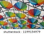 colorful unbrellas background.... | Shutterstock . vector #1199154979