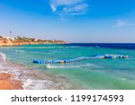 sunny resort beach with palm... | Shutterstock . vector #1199174593