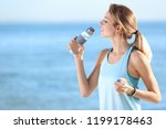 young woman drinking water from ... | Shutterstock . vector #1199178463