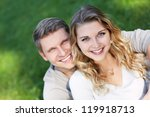 happy young couple outdoors | Shutterstock . vector #119918713