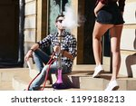 a man smoking a hookah sitting...   Shutterstock . vector #1199188213