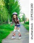 little girl learning to roller... | Shutterstock . vector #1199236180