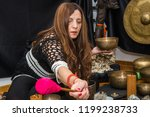 woman playing a singing bowls... | Shutterstock . vector #1199238733