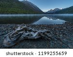 pre dawn fog on a mountain lake.... | Shutterstock . vector #1199255659