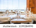 table with plates  glasses and... | Shutterstock . vector #1199284990