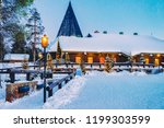 santa claus village at sunset... | Shutterstock . vector #1199303599