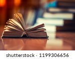 open book on the table | Shutterstock . vector #1199306656