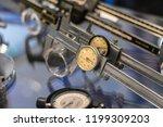 sliding callipers on table. | Shutterstock . vector #1199309203