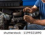 car mechanic or serviceman... | Shutterstock . vector #1199321890