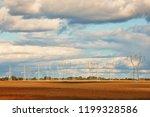high voltage power line on an... | Shutterstock . vector #1199328586