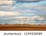 high voltage power line on an... | Shutterstock . vector #1199328589