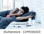 sick attractive woman lying in... | Shutterstock . vector #1199336323