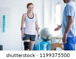 woman walking with crutches... | Shutterstock . vector #1199375500