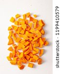 cut into pieces raw pumpkin on... | Shutterstock . vector #1199410579