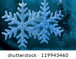 christmas snowflakes on blue... | Shutterstock . vector #119943460