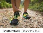 asian woman runner hold her... | Shutterstock . vector #1199447413