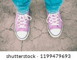 violet sneakers on the cracked... | Shutterstock . vector #1199479693