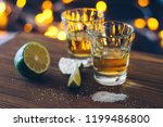 shot of tequila with lime and... | Shutterstock . vector #1199486800