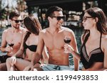young smiling friends drinking... | Shutterstock . vector #1199493853