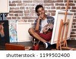 young african american artist... | Shutterstock . vector #1199502400