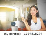 happy business woman holding a ... | Shutterstock . vector #1199518279