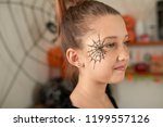 half turned portrait of little... | Shutterstock . vector #1199557126