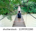 man sitting on the middle of... | Shutterstock . vector #1199592280