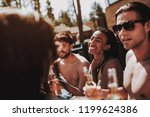 young friends with alcoholic... | Shutterstock . vector #1199624386