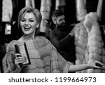 lady tries expensive mink...   Shutterstock . vector #1199664973