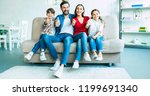 smiling beautiful modern family ... | Shutterstock . vector #1199691340