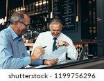 happy senior business people... | Shutterstock . vector #1199756296