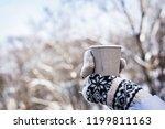 hot drink in woman's hands... | Shutterstock . vector #1199811163