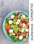 fresh vegetable salad. caprese. ... | Shutterstock . vector #1199829733