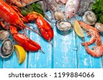 Shellfish and crustacean seafood with selection of fresh lobster, shrimp, fish, oyster, squid and crab on dark rustic background.