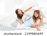 pajamas party for kids. girls... | Shutterstock . vector #1199884699