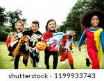 little kids at a halloween party | Shutterstock . vector #1199933743