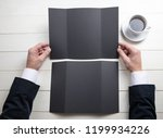 mens hands holding empty black...   Shutterstock . vector #1199934226