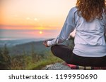 woman do yoga exercises at top... | Shutterstock . vector #1199950690