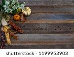several small pumpkins    corn ...