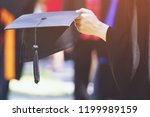 graduation student hold hats in ... | Shutterstock . vector #1199989159