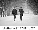 wintertime love. couple during...   Shutterstock . vector #1200015769