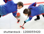 Curling games. the player is...