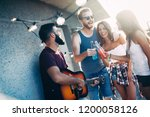 friends having fun and drinking ... | Shutterstock . vector #1200058126