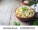 traditional russian salad with... | Shutterstock . vector #1200085333