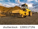 Small photo of Steamroller performing road paving works