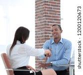 closeup.a handshake of a... | Shutterstock . vector #1200120673