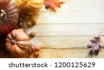 pumpkin on wooden background ... | Shutterstock . vector #1200125629