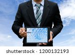 man hold touch screen tablet... | Shutterstock . vector #1200132193